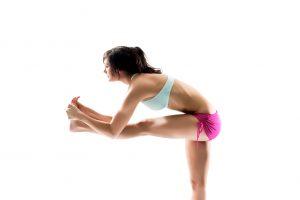 Hot Yoga teacher Jen Rose standing head to knee pose